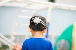 A child suffering from a traumatic brain injury can recover over time with love and treatment.